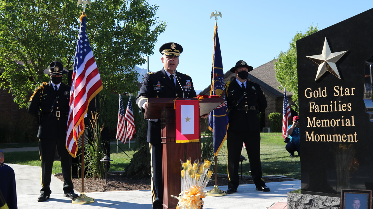 Brig. Gen. Michael Turley, the Adjutant General for the Utah National Guard gave remarks before Gold Star Families, dignitaries from Utah and Washington D.C., and local sponsors following the unveiling of the Gold Star Family Memorial Monument August 1st in North Ogden City, Utah at City Hall, expressing his support for families of service members. (U.S. Army photo by Cpt. Rory Mele)