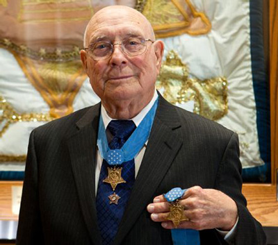 Woody Williams with Medal of Honor in his hand